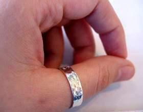 Что означает кольцо на большом пальце фото