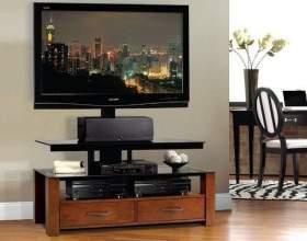 Как выбрать тумбочку под телевизор фото