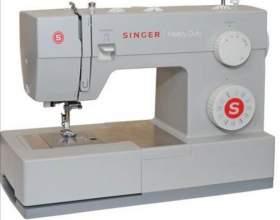 Как заправить на швейной машинке челнок фото