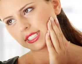 Почему зуб может отойти от десны фото