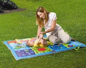 Как выбрать развивающий коврик для ребенка фото
