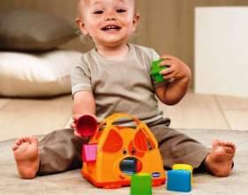 Зачем ребенку игрушка-сортер фото